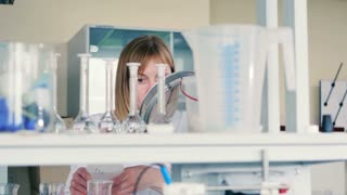 Woman working in the lab near the rack