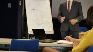 Woman writes a business presentation
