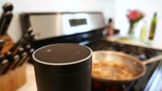 Amazon Alexa / Amazon Echo in Kitchen with Cooking in backgrounding