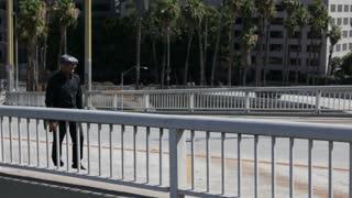 Businessman walks downtown past homeless encampment