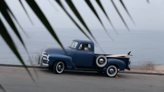 Heading to surf in the early morning in a 1950s Chevy truck.