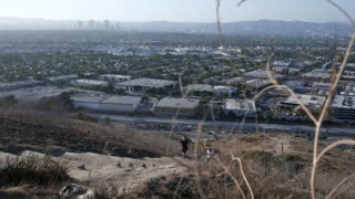 Millenial climbing city stairs in Culver City.  Trail hike.