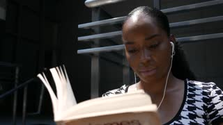 Young African American woman reading a book on a lunch break