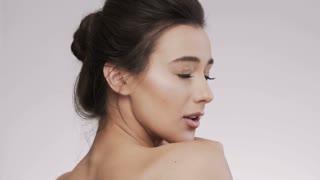 Attractive brunette model at studio background