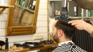 Barber blowdrying and combing hair