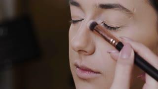 Beautiful girl doing make up