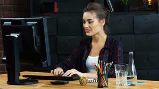 Beautiful girl working with PC