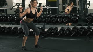 Cute girl doing exercises at gym bacground