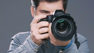 Man filming something on camera