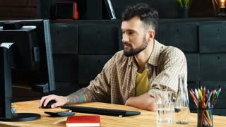 Young man is working on a computer