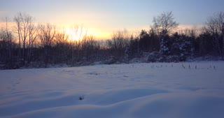 4K Snowy Field Sunrise Slider Shot