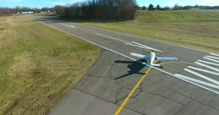 4K Aerial Following Airport Plane Taxiing On Runway Small Airplane Operated With Permission