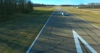 4K Aerial Following Small Plane Taking Off Runway Airport Operated With Permission