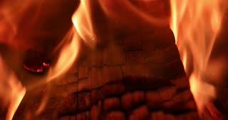 4K Fireplace Burning Wood Fire Hot Stove Macro Slider Shot Focus Pull Back