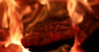 4K Fireplace Burning Wood Fire Hot Stove Macro Slider Shot Focus Push In