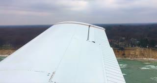 4K Small Airplane Flying Over Lake Michigan Beechcraft Flying