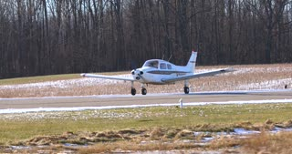 4K Small Airplane Taxiing Down Runway