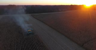 Combine Harvesting Corn Sunset Aerial