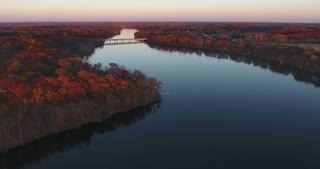 Fall Colors River Aerial Bridge Flyover