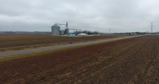 Grain Bin Farm Aerial Road Flyover