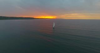 Lake Michigan Aerial Sunset Sailboat Flyby