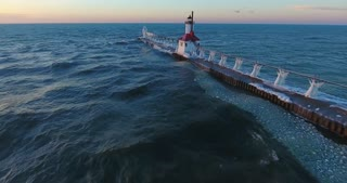 Lighthouse Winter Sunset Aerial Flyby