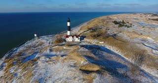 Luddington Lighthouse Winter Aerial Tracking Shot