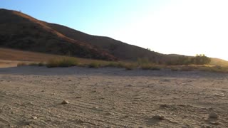 Running Male Slow Mo Gravel Road