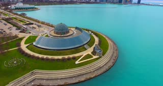 4K Adler Planetarium Aerial Pan Up To Chicago Skyline Buildings City Urban Lake Michigan Water Flying
