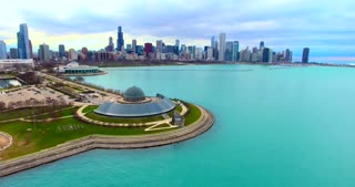 4K Adler Planetarium Chicago Skyline Aerial Circle Shot Buildings City Urban Lake Michigan Water Flying