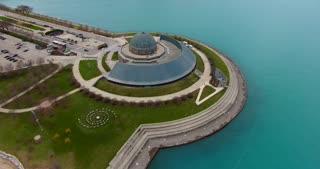 4K Adler Planetarium Chicago Skyline Aerial Pan Up Buildings City Urban Lake Michigan Water Flyover