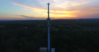 4K Aerial Cell Tower Beautiful Sunset Reception Close Flyover Forest Circle Shot