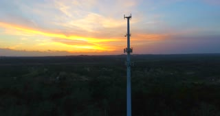 4K Aerial Cell Tower Beautiful Sunset Reception Close Flyover Forest Circle Right Shot