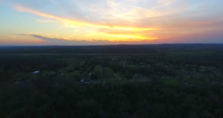 4K Aerial Cell Tower Beautiful Sunset Reception Close Flyover Forest Pull Back