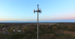 4K Aerial Cell Tower Beautiful Sunset Reception Flyover Forest Junk Yard Pan Down