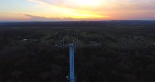 4K Aerial Cell Tower Beautiful Sunset Reception Flyover Forest Pull Back Down