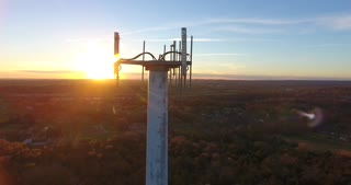 4K Aerial Cell Tower Beautiful Sunset Reception Forest Close Circle Shot
