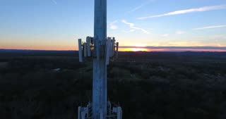 4K Aerial Cell Tower Beautiful Sunset Reception Forest Close Flyby Shot