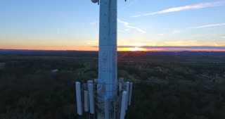 4K Aerial Cell Tower Beautiful Sunset Reception Forest Close Rising Shot