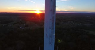 4K Aerial Cell Tower Beautiful Sunset Reception Forest Jib Lowering Shot