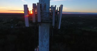 4K Aerial Cell Tower Beautiful Sunset Reception Forest Jib Rising Shot