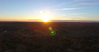 4K Aerial Cell Tower Beautiful Sunset Reception Forest Pull Back Shot
