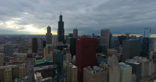 4K Aerial Chicago Skyline Buildings City Urban Establishing Shot Flying Cna Building Willis Tower Helicopter Rising Orbit Right