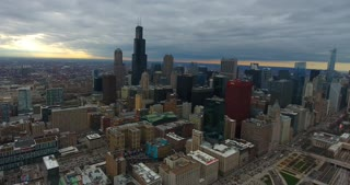 4K Aerial Chicago Skyline Buildings City Urban Establishing Shot Flying Cna Building Willis Tower Helicopter Pull Back Shot