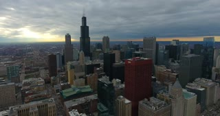 4K Aerial Chicago Skyline Buildings City Urban Establishing Shot Flying Cna Building Willis Tower Helicopter Rising Orbit Left