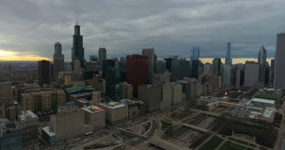 4K Aerial Chicago Skyline Buildings City Urban Establishing Shot Flying Cna Building Willis Tower Helicopter Decending Shot