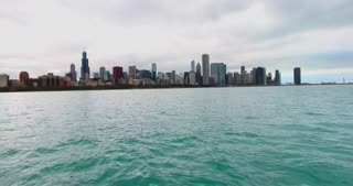 4K Aerial Chicago Skyline Buildings City Urban Lake Michigan Water Flying Left Rising