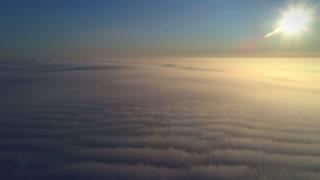4k Aerial Clouds Sunrise Waves Flying Reveal