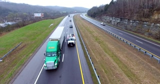 4K Aerial Freeway Cable Cam Right Trucks Transportation Vehicles Driving On Tennessee Road