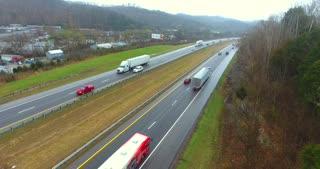 4K Aerial Freeway Circle Shot Trucks Transportation Vehicles Driving On Tennessee Road